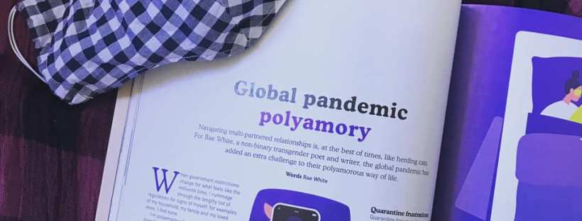 Photo of a magazine spread with a chequered mask sitting nearby