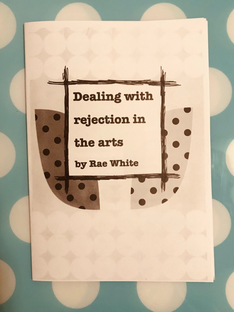 Photo of a black and white zine with a spotty design and the text 'Dealing with Rejection in the Arts.'